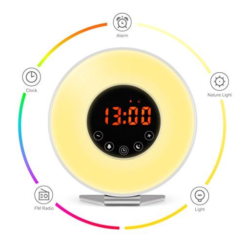 Wake Up Light Alarm Clock - 7 Color Light - Sunrise Simulator With Night Light, Nature Sounds or FM Radio Alarm - Touch Control - Include USB Charger - Make It Easier To Get Up In The Morning With This Alarm Clock As human beings, it's natural for us to wake up as the sun rises. But our modern schedules rarely allow us to lie in bed until the sun decides to wake us. Instead, we rely on loud and jarring alarm clocks to rouse us from our slu...
