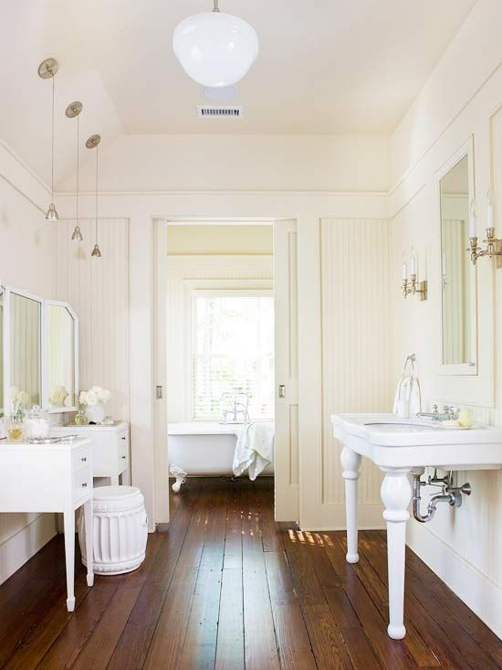 Clean and Fresh.  With the different tones of White and Cream accented by the old Barn-wood floor, you can't help but want to relax all day in this sunlit bathroom.  I've always wanted a claw foot tub too.