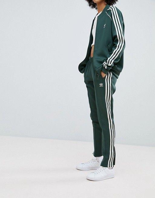 84b35c806bf4 adidas Originals adicolor Three Stripe Track Pants In Green ...