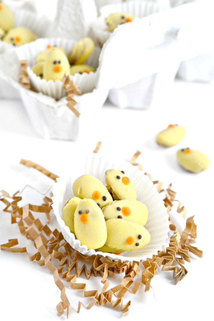 Dip almonds into nondairy white chocolate and then you have the cutest Easter Almond Baby Chicks!
