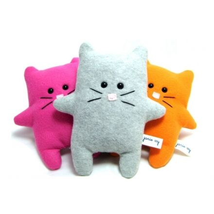 Cute and cuddly plush toy, Ramses the Cat, in pink, gray, and orange.
