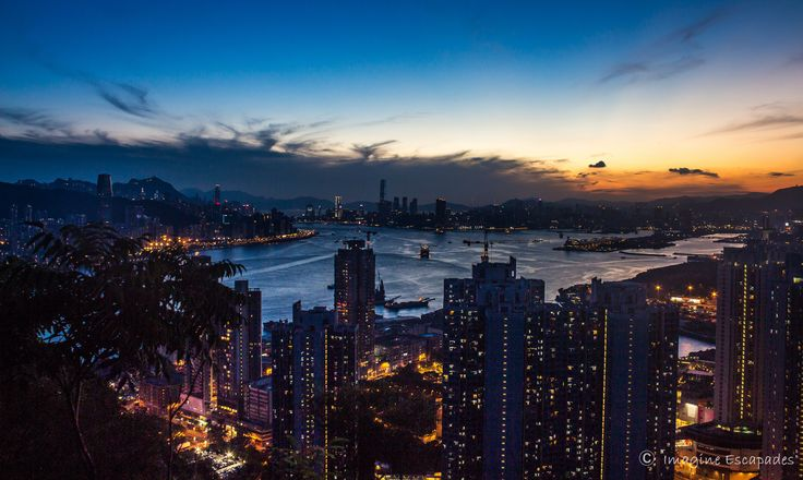 One of Hongkong's best sunset photography lookout points , with the open waters of South China sea on one side and the waters of the Victoria Harbour flowing through in between Hong Kong and Kowloon , the view magnificent with the city lights and a stunning sunset in the backdrop
