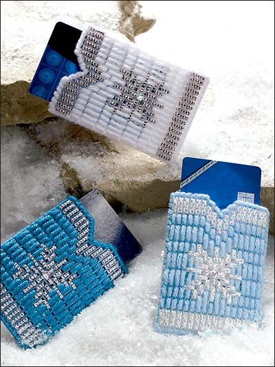 Snowflake Gift Card Sleeves ~~ Present your Christmas gift cards in these quick-to-make sleeves. Metallic cords and crystal rhinestones make these small projects sparkle. Technique - Plastic Canvas Skill Level: Beginner