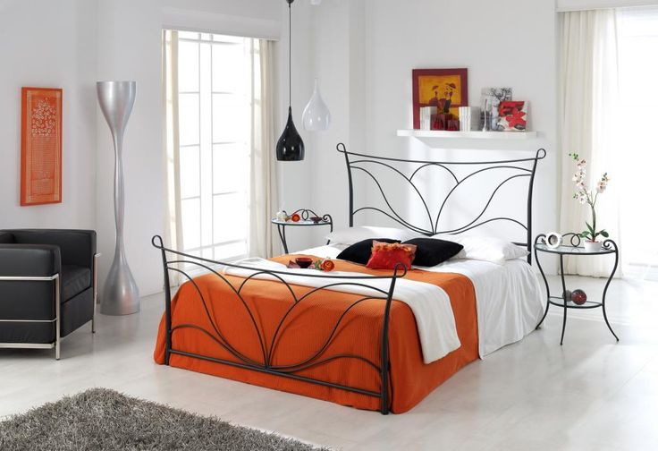 http://www.drissimm.com/wp-content/uploads/2015/02/interesting-metal-bed-design-in-modern-bedroom-interior-with-orange-duvet-cover-plus-white-bedding-set-including-gray-furry-rug-on-floor-as-well-pendant-lamps-above-round-table.jpg