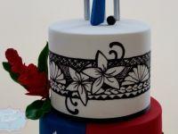 Samoan themed 65th birthday cake with kilikiti bat topper