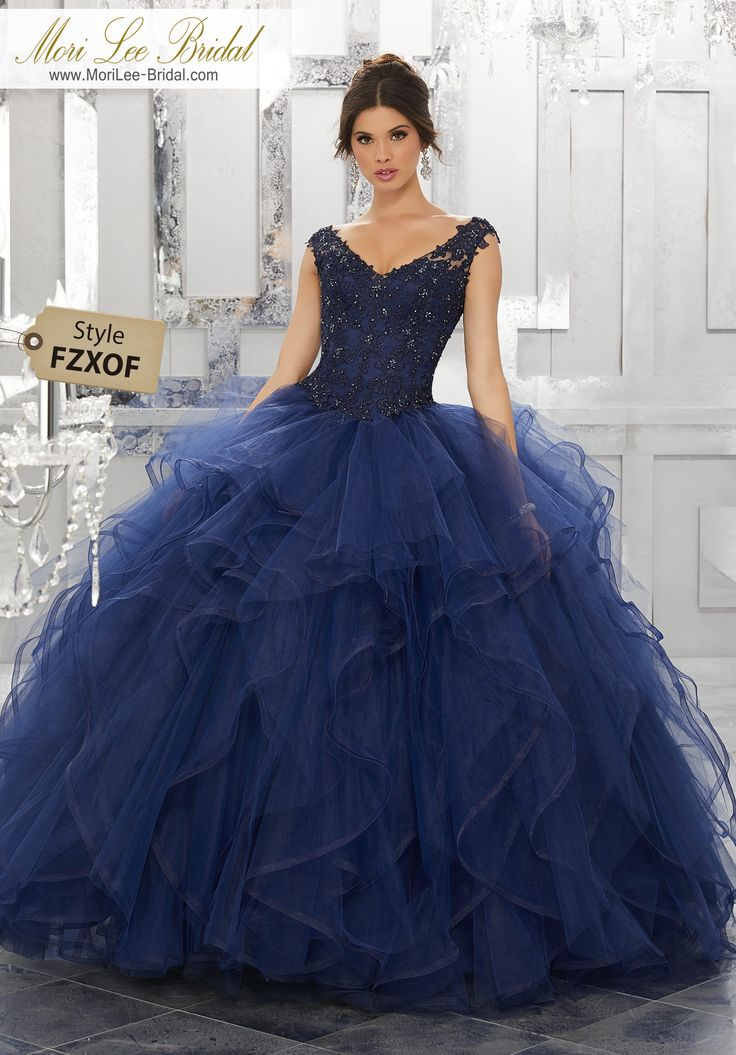 Style FZXOF Beaded Lace Appliqués on a Flounced Tulle Ball Gown Dramatic and Elegant, This Quinceañera Ballgown Beautifully Combines an Intricate Lace Bodice Featuring Off-the-Shoulder Cap Sleeves. The Full Flounced Skirt is Trimmed in Horsehair. Matching Stole Included. Corset Back. Colors Available: Bahama Blue, Black Cherry, Royal, White.