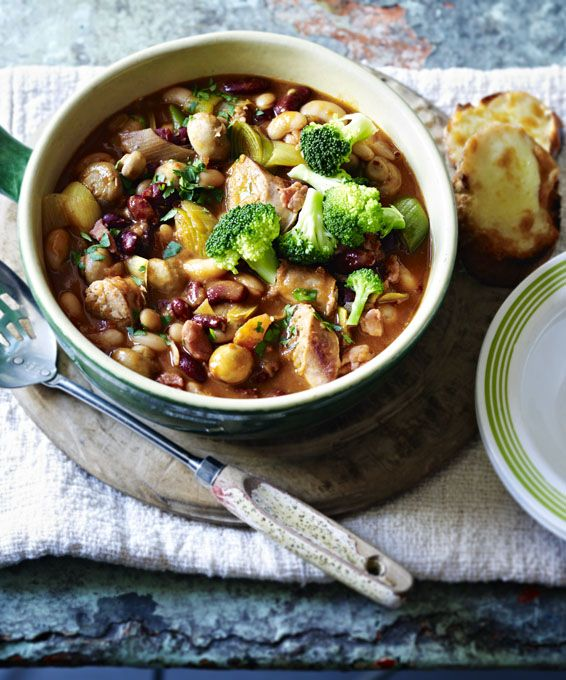 Warm up with this homely, comforting bean and sausage hotpot served with melting cheese toasts