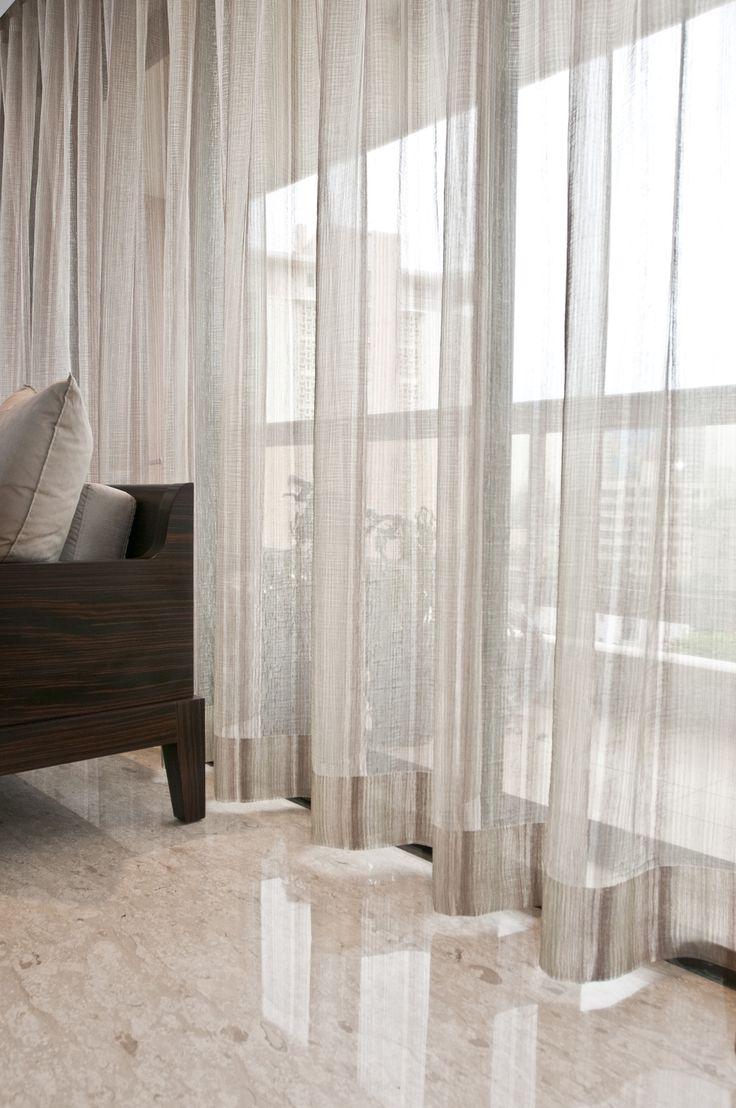The distinctive shape of S-Fold curtains.