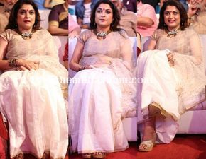 Ramya Krishnan in white tissue silk saree for bahubali movie audio launch tripathi