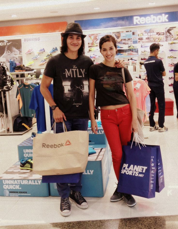 Vino G. Bastian and Marsha Timothy in PlanetSports store