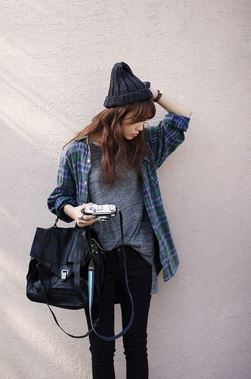 A navy and green plaid oxford shirt and black skinny jeans feel perfectly suited for weekend activities of all kinds.  Shop this look for $47:  http://lookastic.com/women/looks/skinny-jeans-backpack-dress-shirt-crew-neck-t-shirt-beanie/5982  — Black Skinny Jeans  — Black Leather Backpack  — Navy and Green Plaid Dress Shirt  — Charcoal Crew-neck T-shirt  — Charcoal Beanie