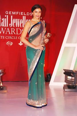 Material Type  Saree : Net Fabric Blouse : Dhupiyan Petticoat: Satin Work : Multi Sequence Weight : 1 kg