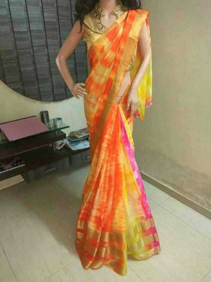 SHIBORI with 3 golden patti Georgette SAREE  Saree stuff: pure Georgette 4_5D SHIBORI Saree Description: pure Georgette Shibori SAREE with 3 golden patti at the bottom of saree. Length: 5:5 meter Blouse: No(without Blouse) Wash : DRY wash only