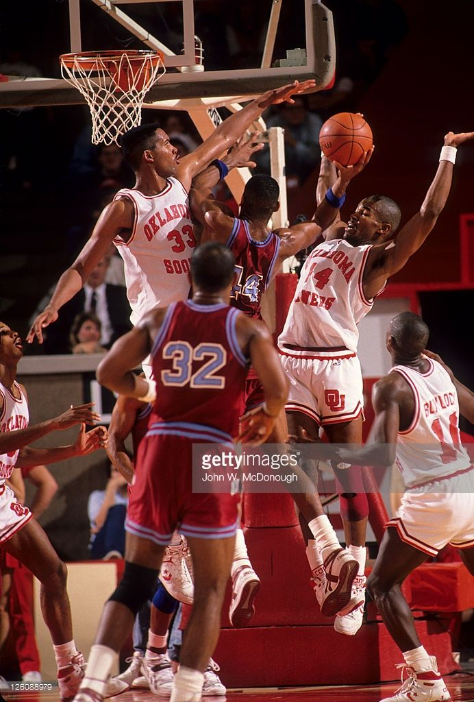 Oklahoma William Davis (44) and Stacey King (33) in action, defense vs Loyola Marymount Hank Gathers (44) at Lloyd Noble Center. John W. McDonough F25 )
