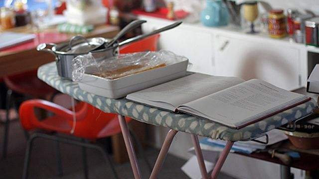 small kitchen + bake-a-thon??? Grab your ironing board for much needed extra cooling space.  (my ironing board is an antique and huge. I remove the Genious -- use for extra cooling space when baking for parties, holidays, etc.  cover and even use it when we need an impromptu buffet server.. like during showers & parties. it's cool, and rustic.)