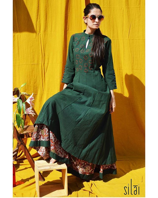 #morefromourcapsulecolelction Green maxi dress layered with a kalamkari skirt.  #threaddetails #darkgreen #red #gamthi #kalamkari #ss16 #flared #crisp #simplicity #minimal #chic