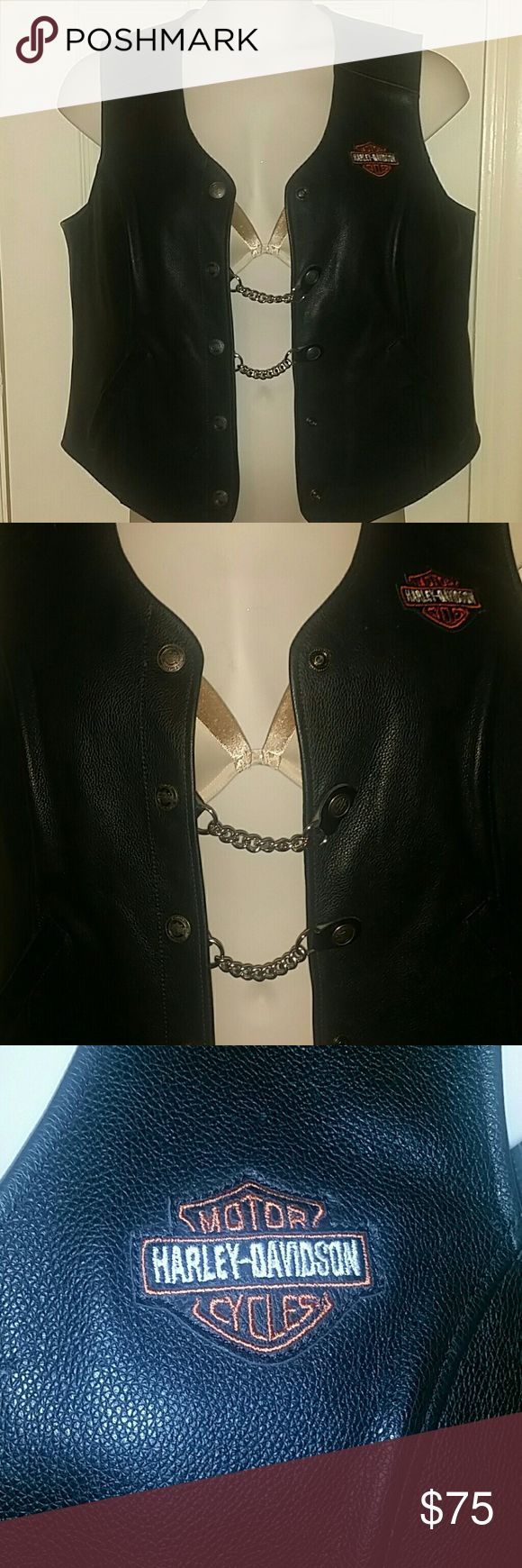 Harley Davidson Leather Vest Beautiful genuine HD leather button down vest..has 2 pockets and comes with 2 chain extenders...the extension chains change the look of the vest while allowing a bit of extra room if and wherever needed..they can even be used to dress up the pockets..size XL women's, but definitely unisex..any HD purchases between  $75 & $100.00 get a free HD gift card Harley Davidson  Jackets & Coats Vests