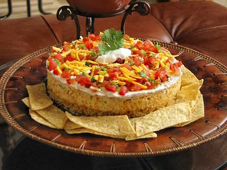 """This beautiful creation will bring oohs and aahs at your next party. A delicious twist on the standard 7-Layer Dip and Cheese Ball, yet it's a showpiece that is just as easy to prepare. The flavor is addicting. Get ready to be hounded for this recipe""    I just don't even.."