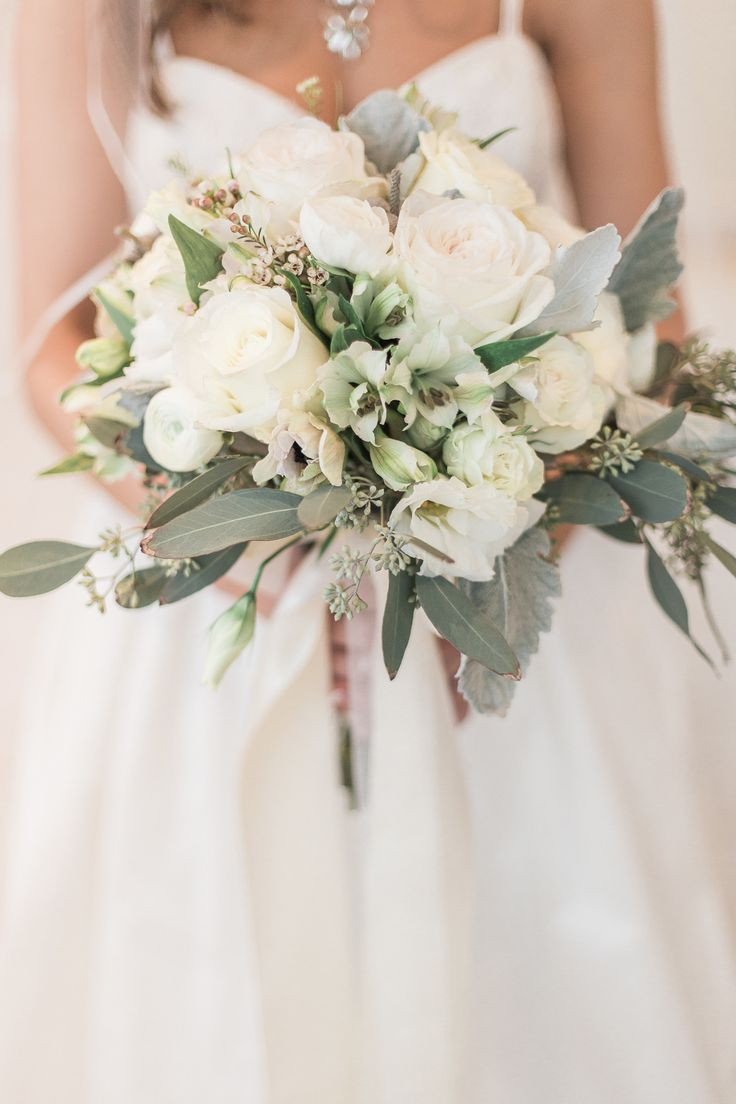 Whimsical winter bouquet: http://www.stylemepretty.com/2015/04/29/golden-chesapeake-bay-beach-club-wedding/ | Photography: Stacy Bauer - www.stacybauerphotography.com
