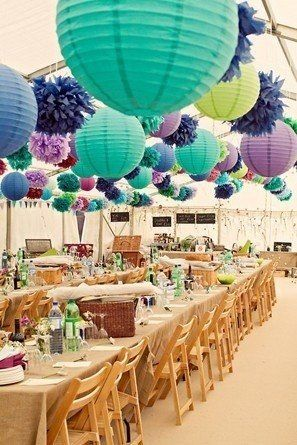 purple and aqua round paper lanterns hanging with poms