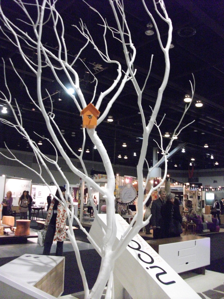 LOVE this! The orange birdhouse is like a beacon of light against the snow-white painted limbs of this tree. The display was in the middle of a huge centre aisle at IDSWest.