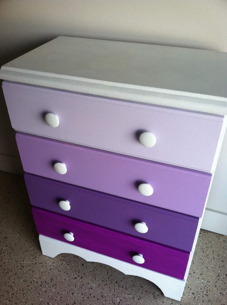 Did this all by myself! Took a dresser I got for free (4 drawers, perfect!) which was ugly primary colors before, and 4 cans of white spray paint and 4 little bottles of purple paint later it turned out flawless! I'm so excited to use it in my apartment :)