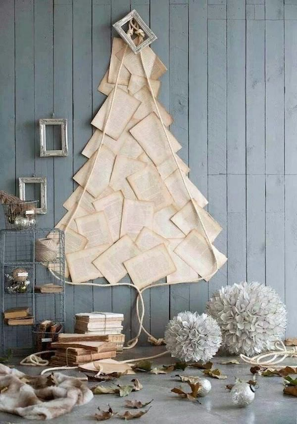 13 Creative ways to build a Christmas tree in small apartments. You can celebrate the holidays in style without taking up one more room in your place. I did #1 on the list last year and I am so happy I did. Saved money, space, and it made a great conversation starter.