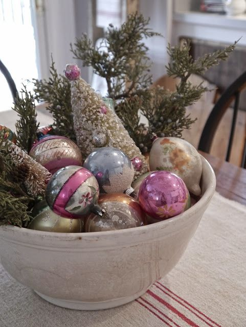 bowl with vintage glass ornaments on display