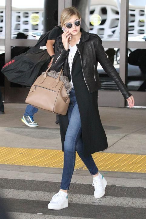 We love Gigi Hadid's casual jeans and sneakers look for the airport. Click to see more great celebrity travel outfits to inspire what you wear when flying home for the holidays