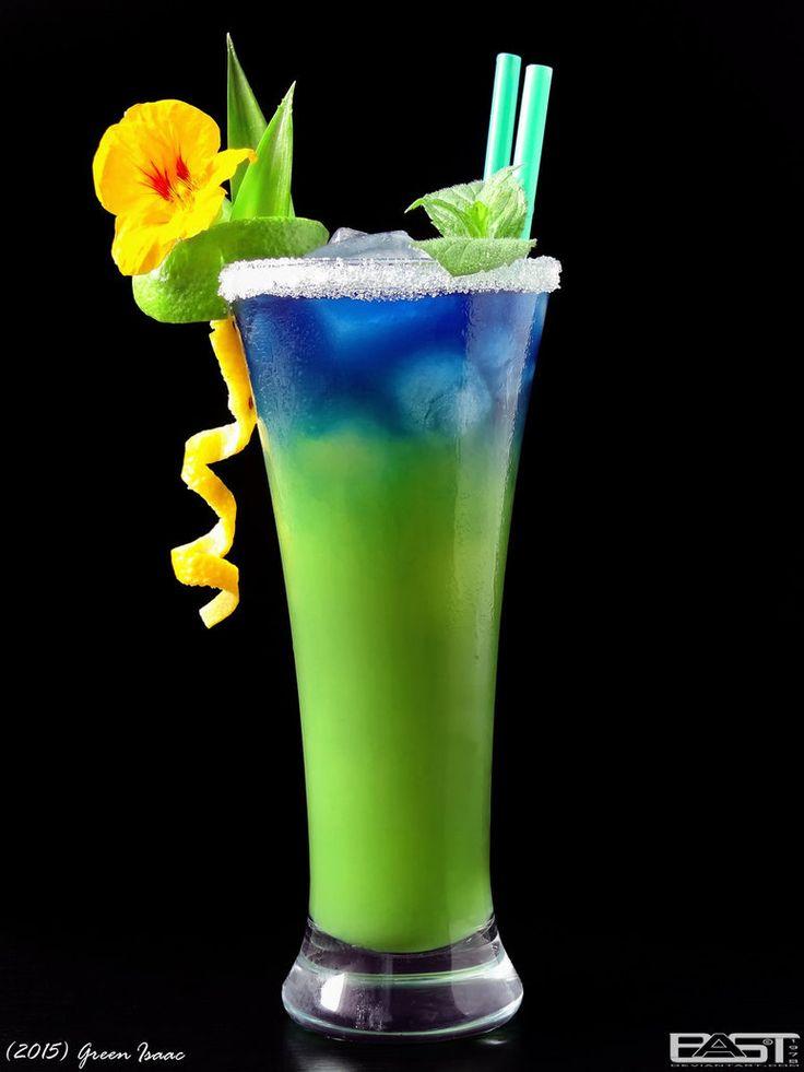 Vodka/ blue Curaçao/ Pineapple juice/ Ice Fill glass with ice. Pour vodka and pineapple juice, and finally carefully refill curaçao