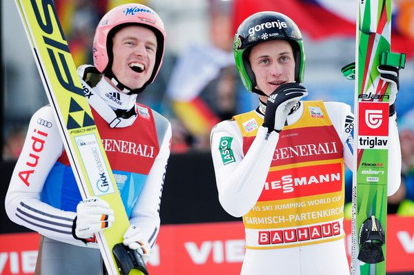 Peter Prevc Photos Photos - Severin Freund of Germany reacts with Peter Prevc of Slovenia after their first competition jump on Day 2 of the 64th Four Hills tounament on January 1, 2016 in Garmisch-Partenkirchen, Germany. - 64th Four Hills Tournament - Garmisch-Partenkirchen Day 2