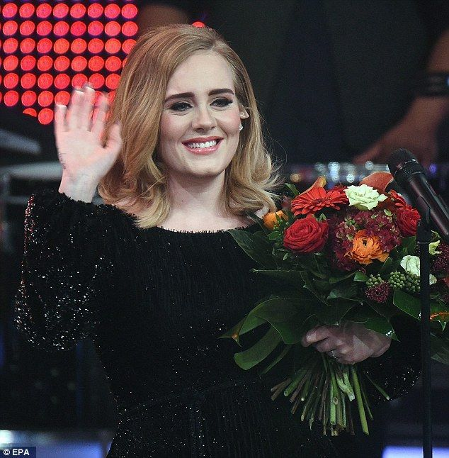 Beaming: Singer Adele looked happy with her latest record breaking album during her TV performance in Germany on Sunday night, for the RTL Television review of the year