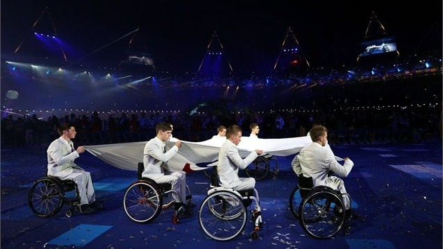 Members of the Great Britain U22 Wheelchair basketball team carry the Paralympic flag during the Opening Ceremony of the London 2012 Paralympics at the Olympic Stadium.