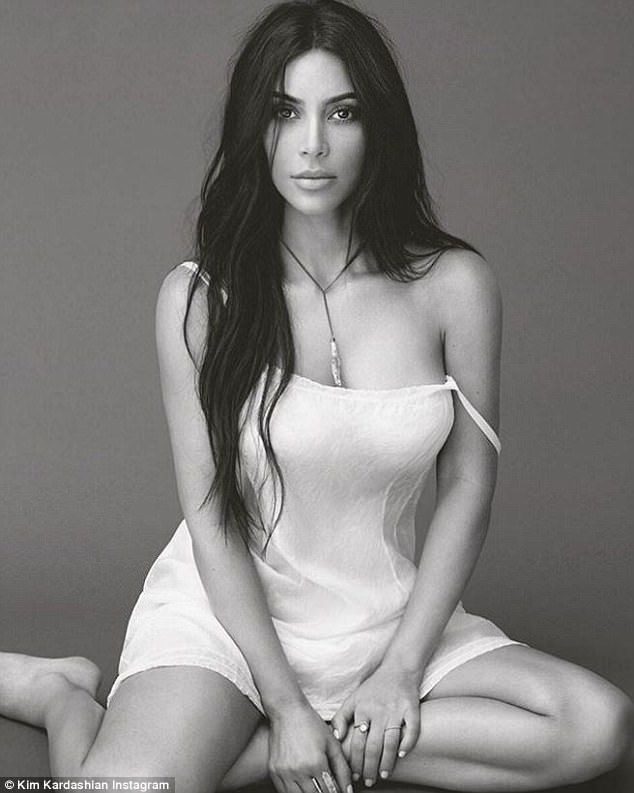 stunning: Kim Kardashian took to her subscription-based website to answer a few questions about her upcoming KKW fragrance launch, as she also shared this sultry snap on Instagram