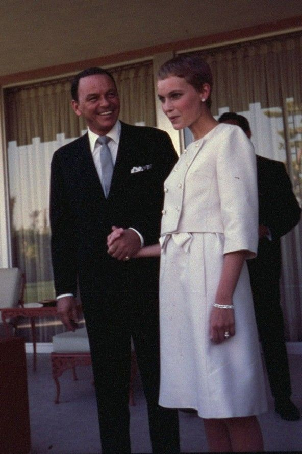 Frank Sinatra's third wedding in June 1966 was to Mia Farrow, who wore a neat skirt suit and who was just 21 at the time (Sinatra was 50). They were famously married in 15 minutes at The Sands Hotel in Las Vegas.