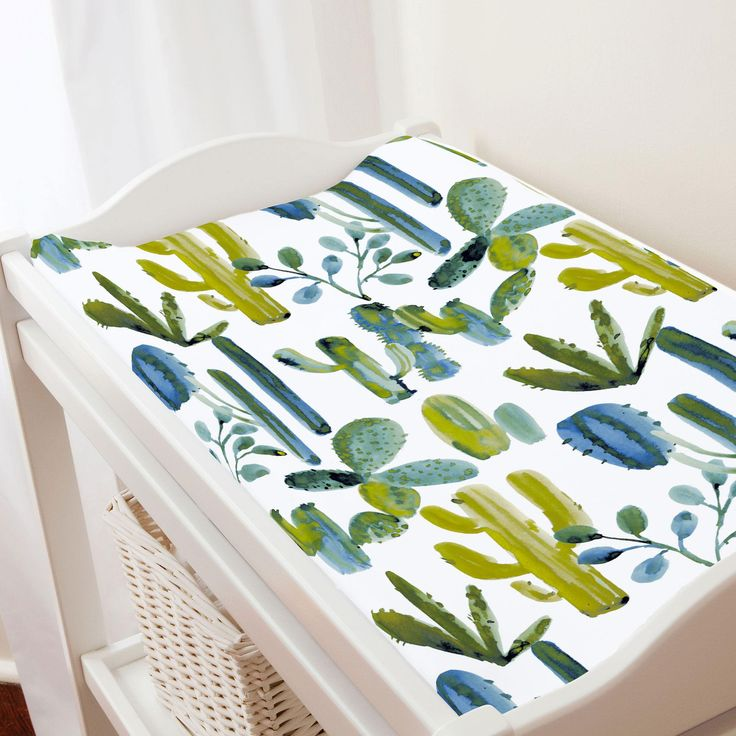 "Blue Painted Cactus Changing Pad Cover by Carousel Designs. Keep your baby comfortable and dry with this changing pad cover, designed to fit most contoured changing pads. Machine washable for easy clean-up. Fits standard contoured changing pads approximately 16"" x 32""."