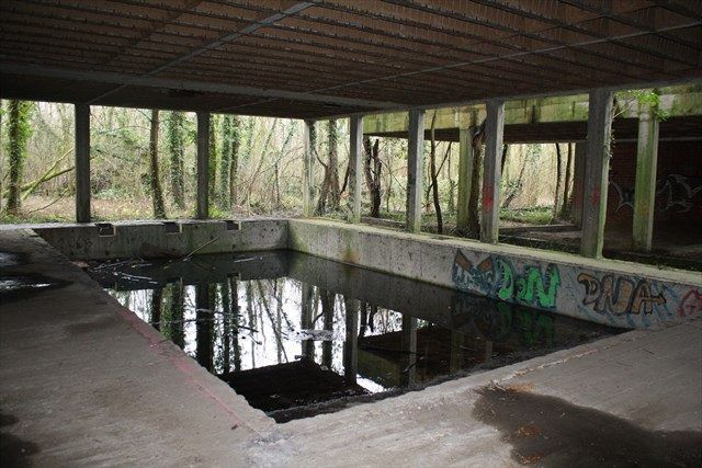 """""""A M N E S I A"""" near Mechelen, Belgium. This mystery cache takes you to a forgotten hotel in the woods. Be careful where you step! A swimming pool and elevator shaft make for careful treading. GC10VTD"""