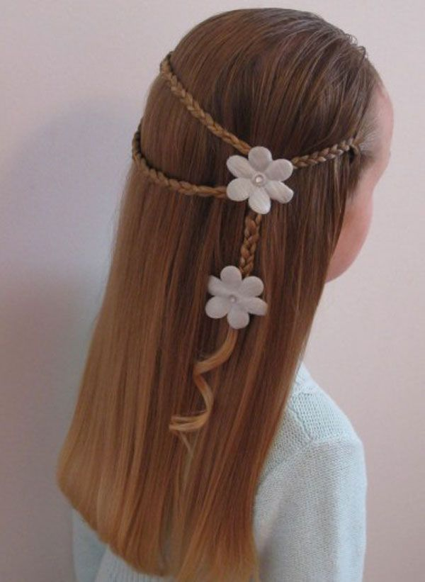 Braid three small groups of hair then pull them together slightly to one side of your head. Secure with a flower, or other cute clip, then make one braid out of the clipped hair and eventually secure that with another cute clip. Gently curl any leftover hair at the bottom.