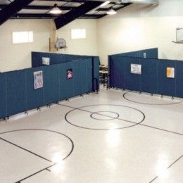 Create temporary classrooms in a gymnasium in just minutes. When not in use, these rolling dividers store compactly in a 2'X3' footprint | Screenflex Portable Partitions