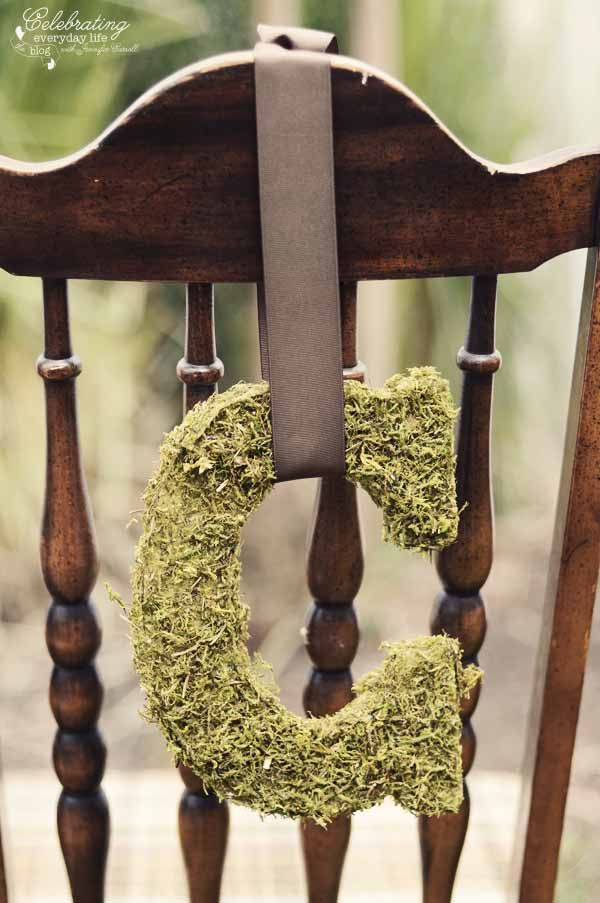 Here's a simple way to decorate the bride and groom's chairs at the reception-- try these DIY moss covered letters!     @jencarrollva