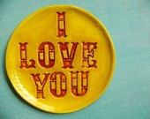 sells at the beehive.  LOVE these  I Love You - stoneware plate in red and yellow