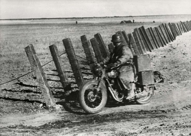 German motorcyclist finds a gap in a Red antitank fence somewhere in the Crimea, 1941. These steel rods were literally hammered to reach a depth of several meters. Barriers like this were effective against anything but the heaviest German tanks -- and even they chose alternate paths if they could find them.