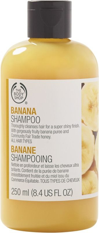 The Body Shop Banana Shampoo, a beauty classic returns. This shampoo gently cleanses hair, leaving it beautifully shiny. It contains real banana puree and smells good enough to eat. (Best Shampoo For Extensions)