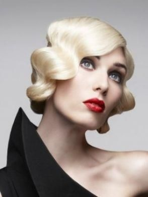 Short chin level blonde with deep defined waves and a side part hairstyle