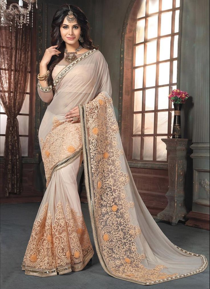 Online shopping store to buy latest designer sarees at amazing prices. Customization and free shipping worldwide. Buy this floral embroidered and patch border work traditional  saree.