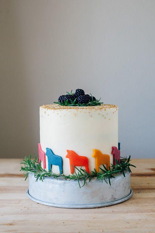 Rosemary Vanilla Cake with Blackberry Preserves, Mascarpone Frosting and Marzipan Dala Horses Recipe by Molly Yeh