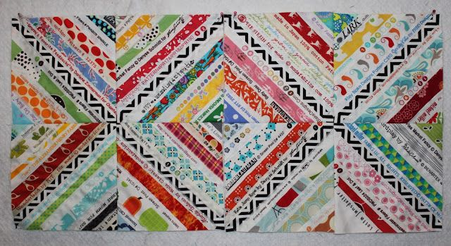 My next selvage quilt, for sure. The black/white unifying strip down the center of each block just MAKES this quilt happen! Lollyquiltz: Save the Selvage: