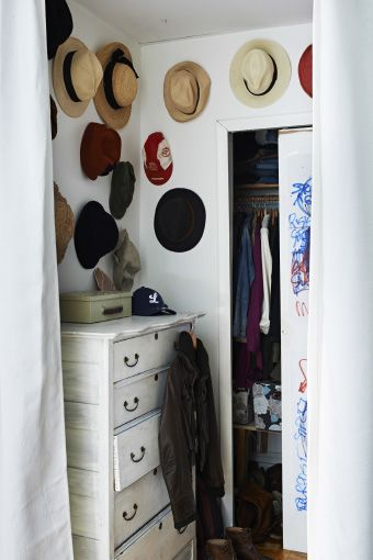 Hang hats on your bedroom wall for a fun display