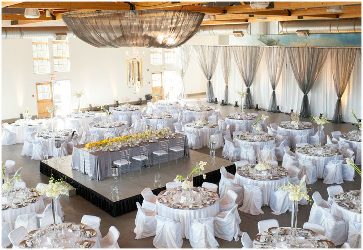 Chic Grey And White Wedding Reception With Pops Of Yellow Raised Head Table In The Center Of