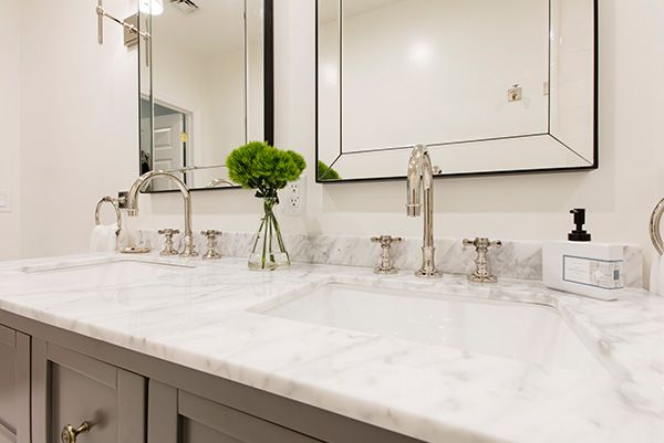 """""""The contractor considered all my sourcing decisions, weighing in where I asked him to and letting me handle things everywhere else. I spent a lot of time researching the fixtures I wanted and although the approach was a bit piecemeal (and largely dictated by stores for which I had gift cards), it worked."""" - Jamie"""